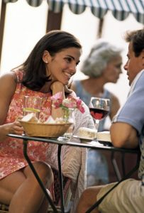 Couple enjoying food and wine at a local restaurant